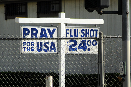 Adjacent signs, prayer & flu shots